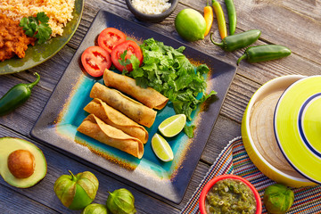 Mexican flautas rolled tacos with salsa