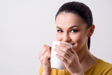 Positive girl drinking tea