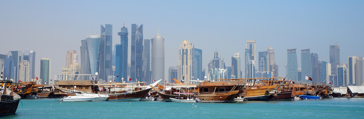 Dhows in front of the skyscrapers of New Doha, Qatar