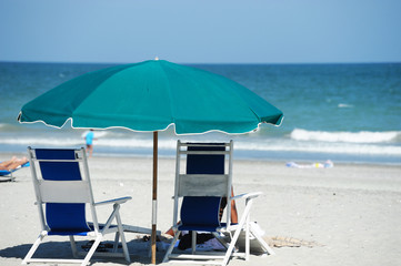 beach umbrella and chairs in summer