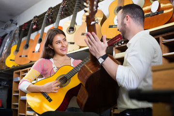 Couple playing the guitars