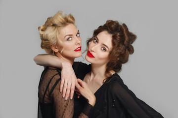two pretty girls flirting and ogling