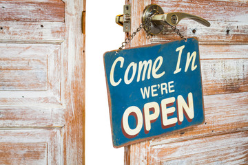 Come In We're Open on the wooden door open, isolated, clipping path on white background