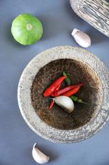 Close up Chili and Garlic in Mortar