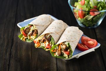 BBQ chicken with fresh salad tortilla wraps