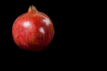 Pomegranate fruit on black background.