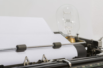 an antique typewriter with a light bulb