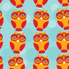 Cute seamless pattern with owl  on a blue background. vector