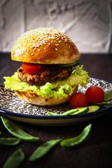 homemade veggie burger in a bun with sesame