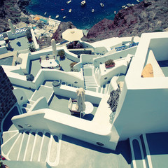 grey and white staircases in volcanic village Oia, Santorini, Greece