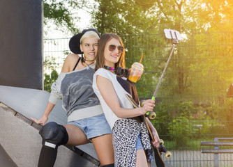 Two female friends taking selfie in skate park