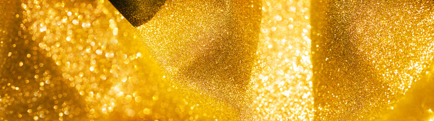 website banner image of shining golden glitter background. panorama