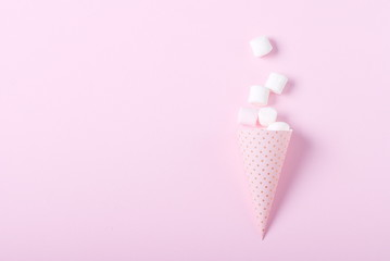 marshmallow on a pink background