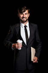 Handsome businessman on black background
