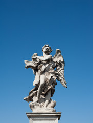 Angel old roman statue on blue sky