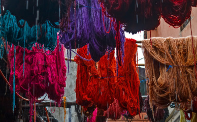 Colored dyed yarn is dried on the streets of Morocco