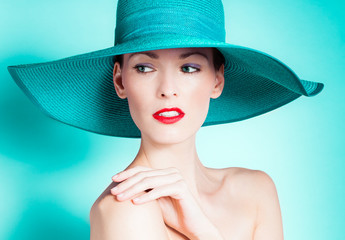 Beautiful female fashion model wearing hat.