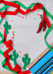A fun Mexican themed border with red and green ribbons wandering in and out of frame