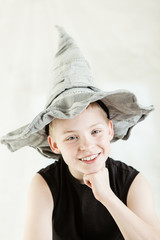 Happy boy wearing gray pointed hat