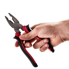 holding pliers on white