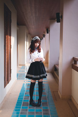 Charming Asian girl in japanese maid costume
