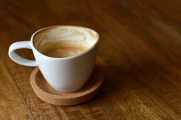 cup of espresso coffee with wooden table background