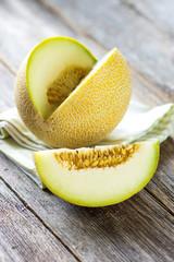 Fresh melon on wooden background