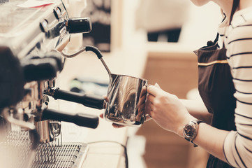Barista preparing coffee in a cafe. Professional coffee brewing, service and catering concept