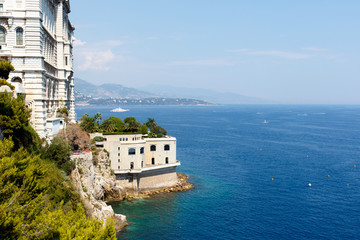 Color DSLR stock image of a building on a cliff overlooking the blue Mediterranean Sea in Monte Carlo in Monaco, on the French Riviera.  Horizontal with copy space for text