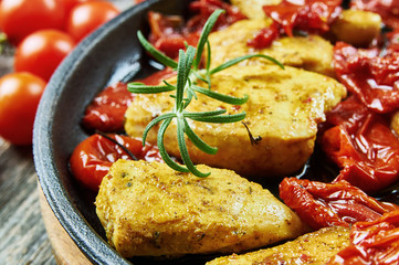 Chicken breasts fried with herbs and dried tomato