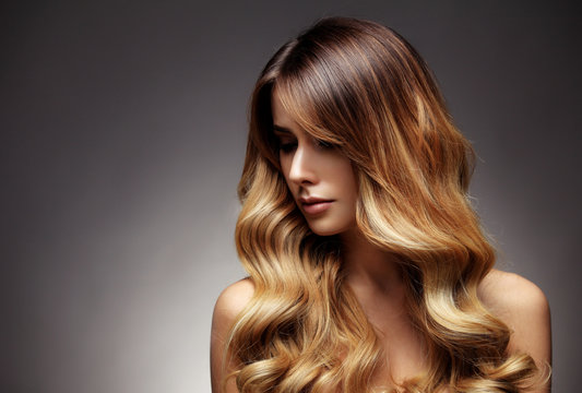 Beautiful blonde woman with long, healthy , straight and shiny hair.