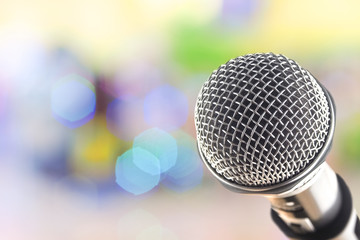 close up microphone on multicolor bokeh background abstract