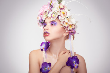 Cute young woman with wreath on head