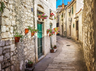 Fototapeten Schmale Gasse Narrow old street and yard in Sibenik city, Croatia, medieval zone