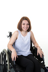 Woman on the wheelchair isolated on white