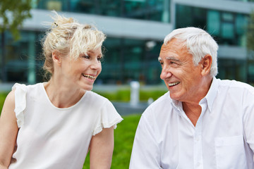Senior couple in love smiling at each other