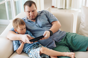 Family using tablet in living room