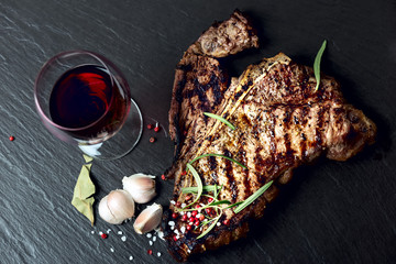 Steak with spices and glass of red wine