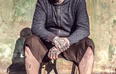 Tattooed mans hands