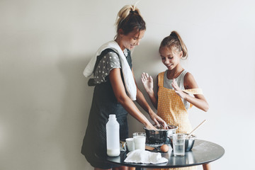 Mom baking with her daughter