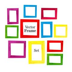 Set of color wooden frames on white background.