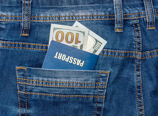 Passport with money in the pocket of jeans