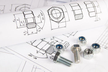 Engineering drawings, metal nuts and bolts. Science, mechanics and mechanical engineering.