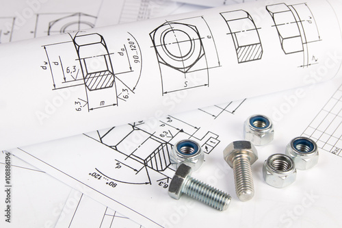 Engineering drawings, metal nuts and bolts. Science, mechanics and ...