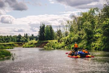 .Tourists raft on river
