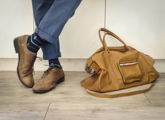 Fashion man legs indigo navy blue pants, navy anchor socks, leather shoes and leather tote bag ( Vintage tone color )