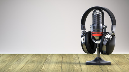 Microphone and headphones on wooden table