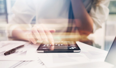Investment manager work process.Closeup photo business woman showing report modern tablet screen.Statistics graphic screen.Banker ready for signs document,new startup.Horizontal,bokeh and film effects