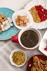 Keuken foto achterwand Bakkerij Cup of tea with aromatic dry tea on wooden background