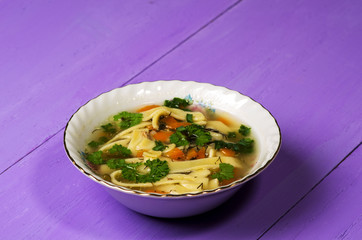 soup in plate on wooden table